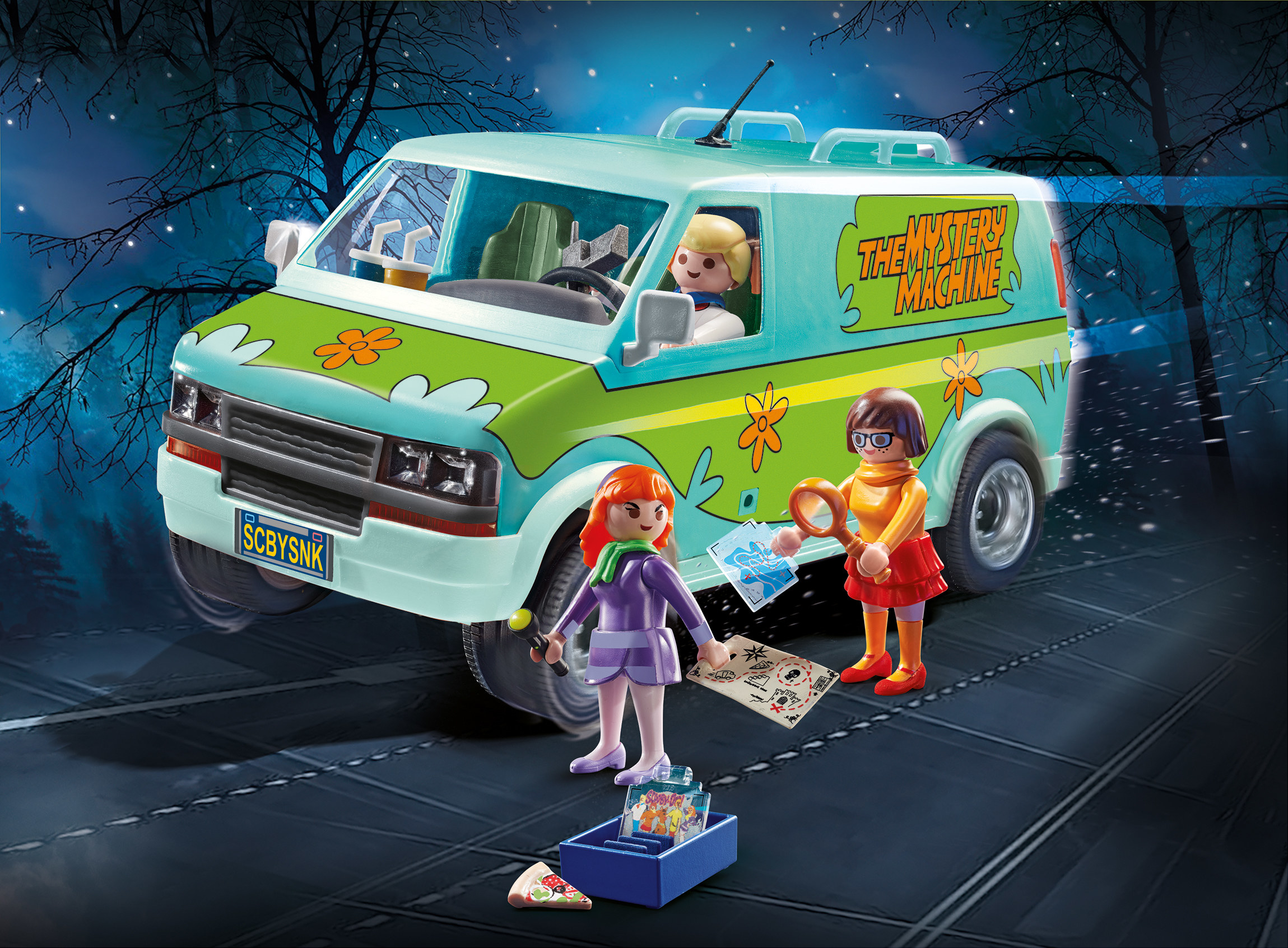 A Mystery Machine toy with figures of Fred, Daphne and Velma from the Scooby Doo television series