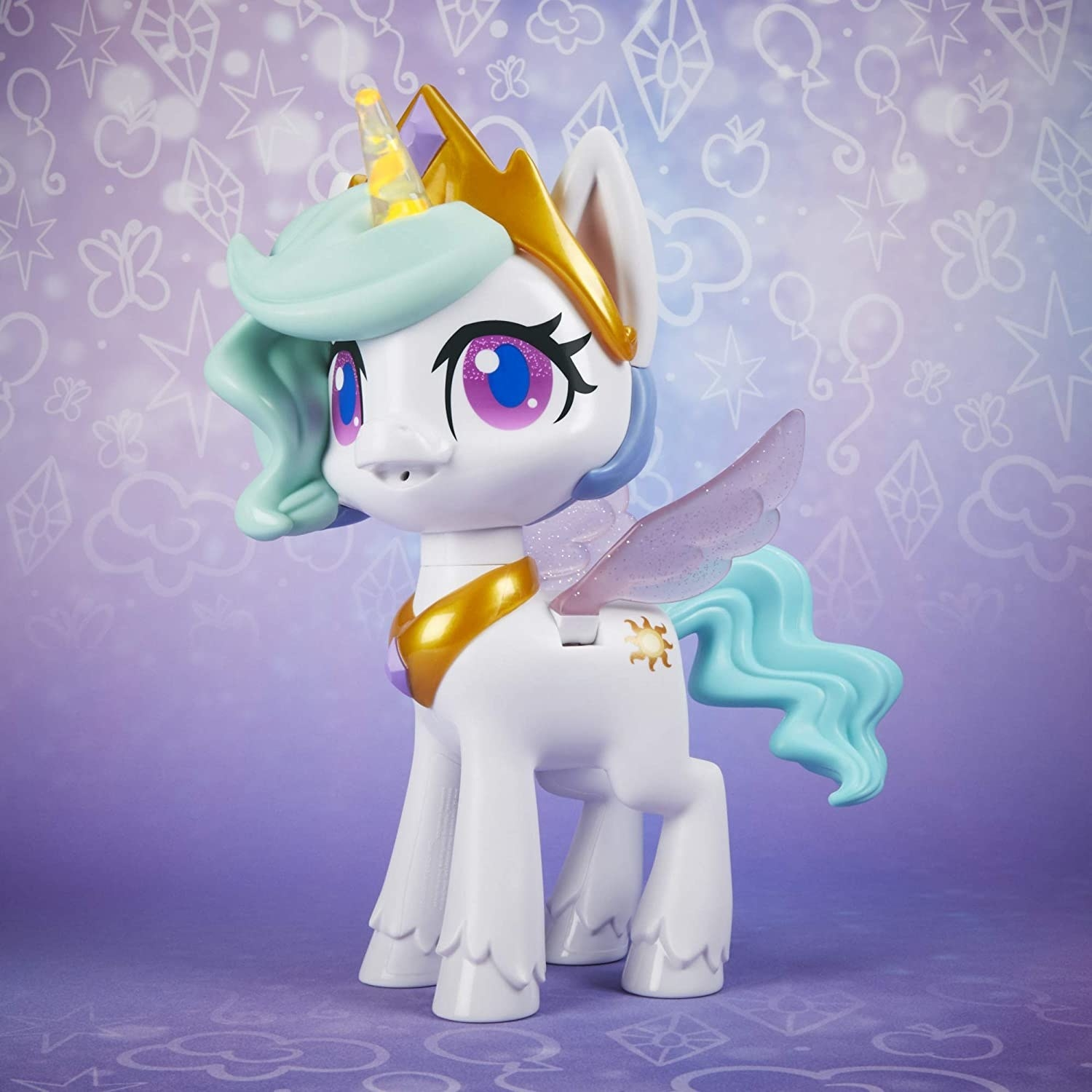 White My Little Pony toy with unicorn horn, wings, and blue mane and tail