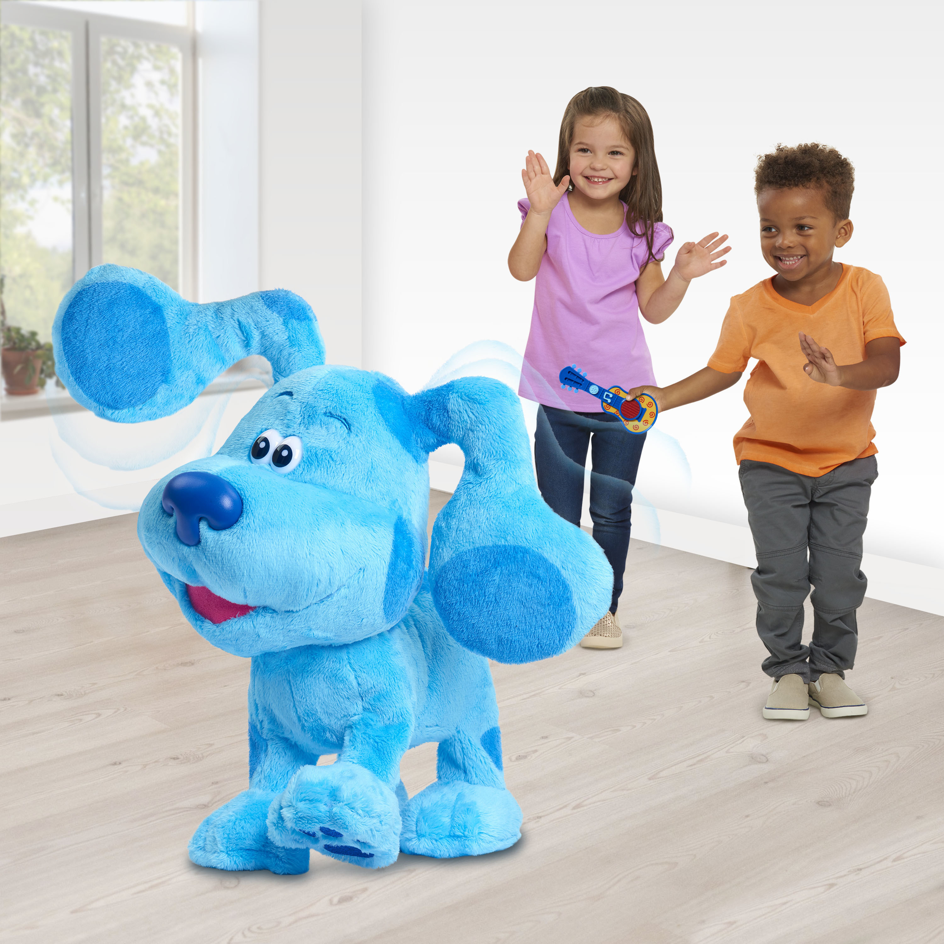 Two children dancing along with the Blue Clue's & You Dance-Along Plush