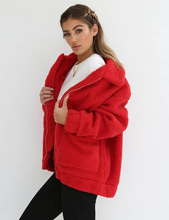 Model wearing the red teddy bear jacket with white t-shirt
