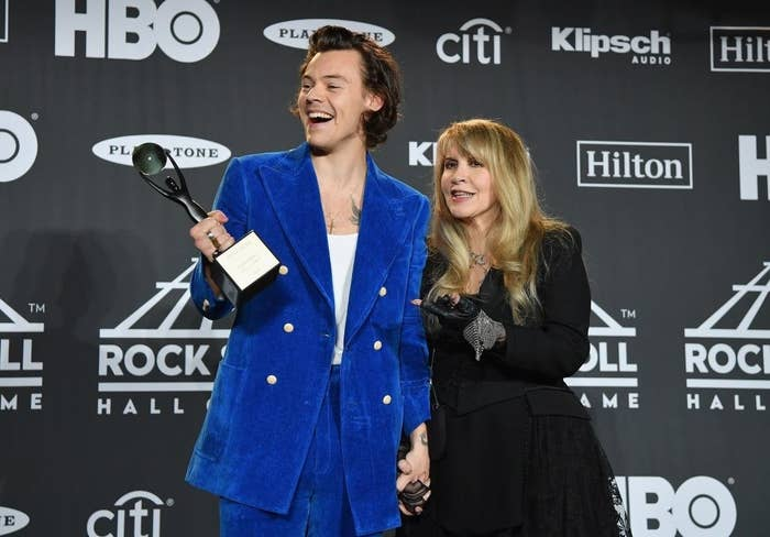 Harry and Stevie Nicks pose together backstage at the Rock & Roll Hall Of Fame Induction Ceremony