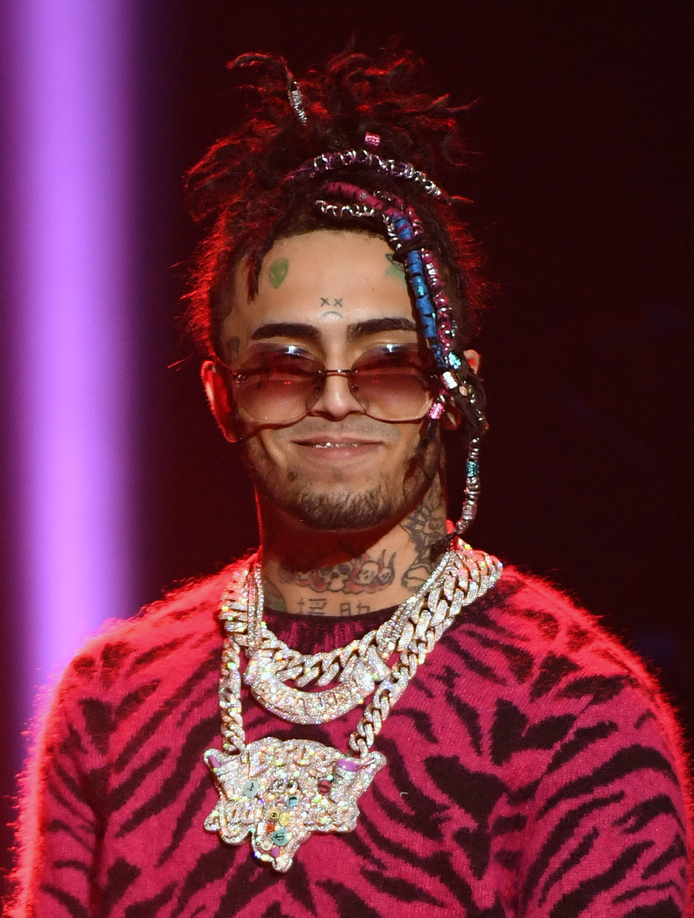 Lil Pump smiling while wearing several diamond chains
