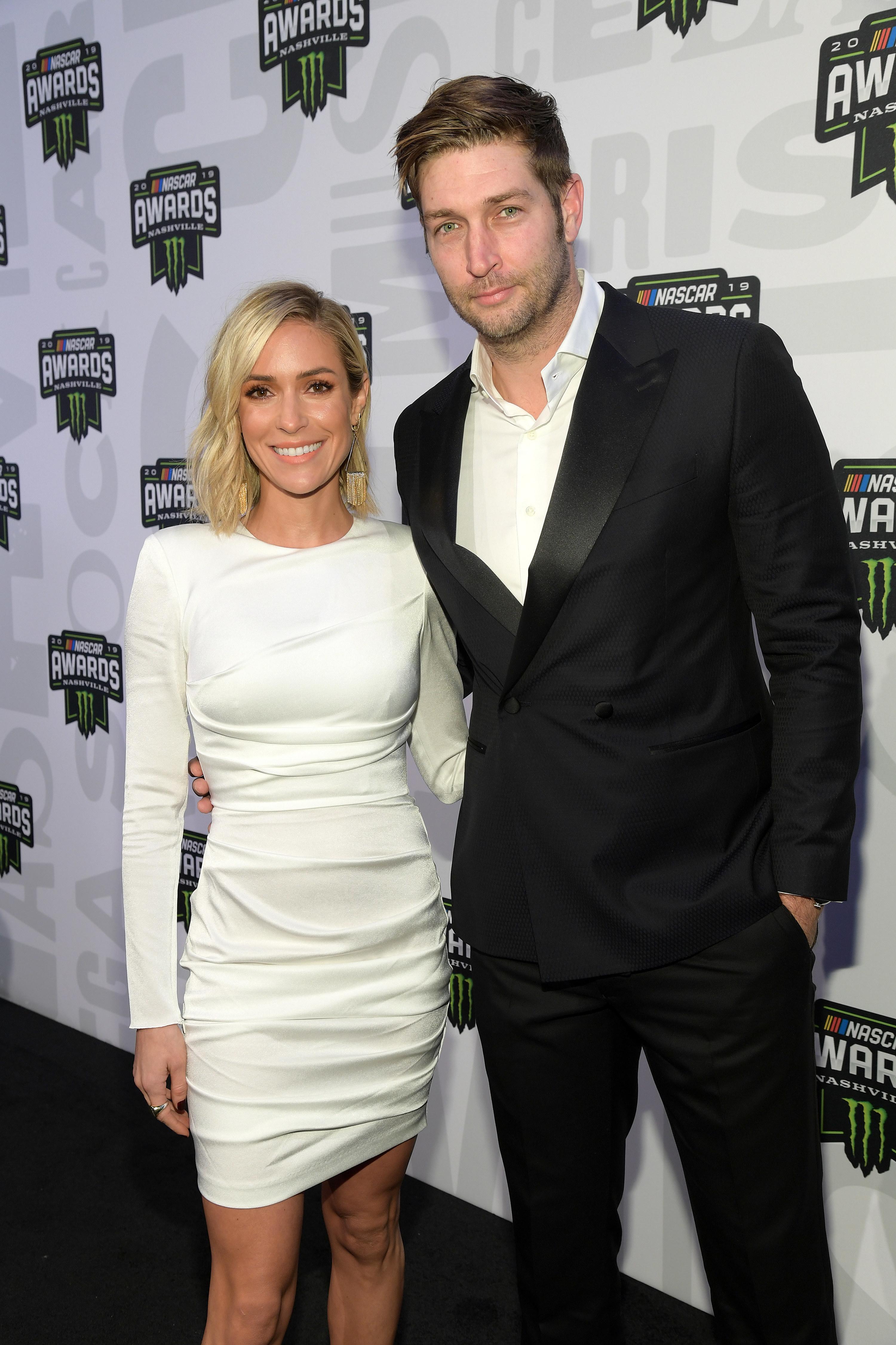 Kristin Cavallari posing  with ex-husband Jay Cutler at the 2019 Nascar Awards