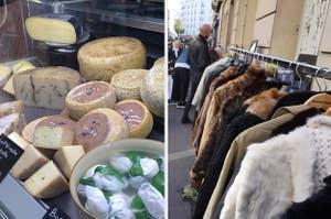 a display cabinet of cheese and a rack of coats at a street market
