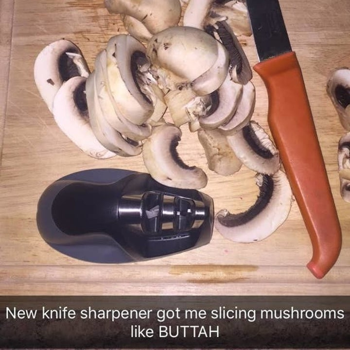 Image of knife sharpener on chopping board with mushrooms and knife