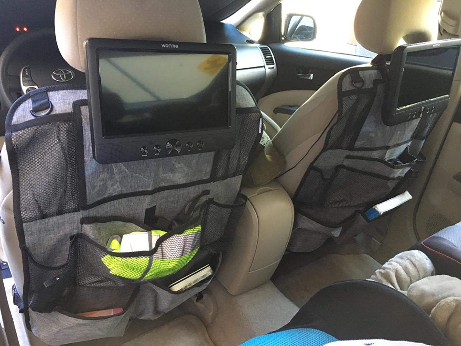 Reviewer image of two helteko backseat organizers in a car