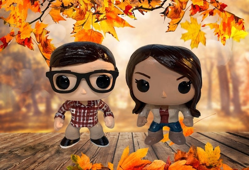 Funko Pop-looking toys that look like a boy with black hair and glasses and a girl with tan skin and dark hair