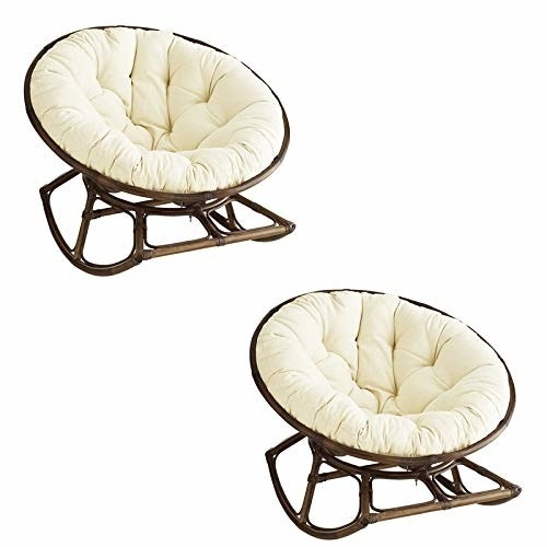Cushions kept on round chairs.