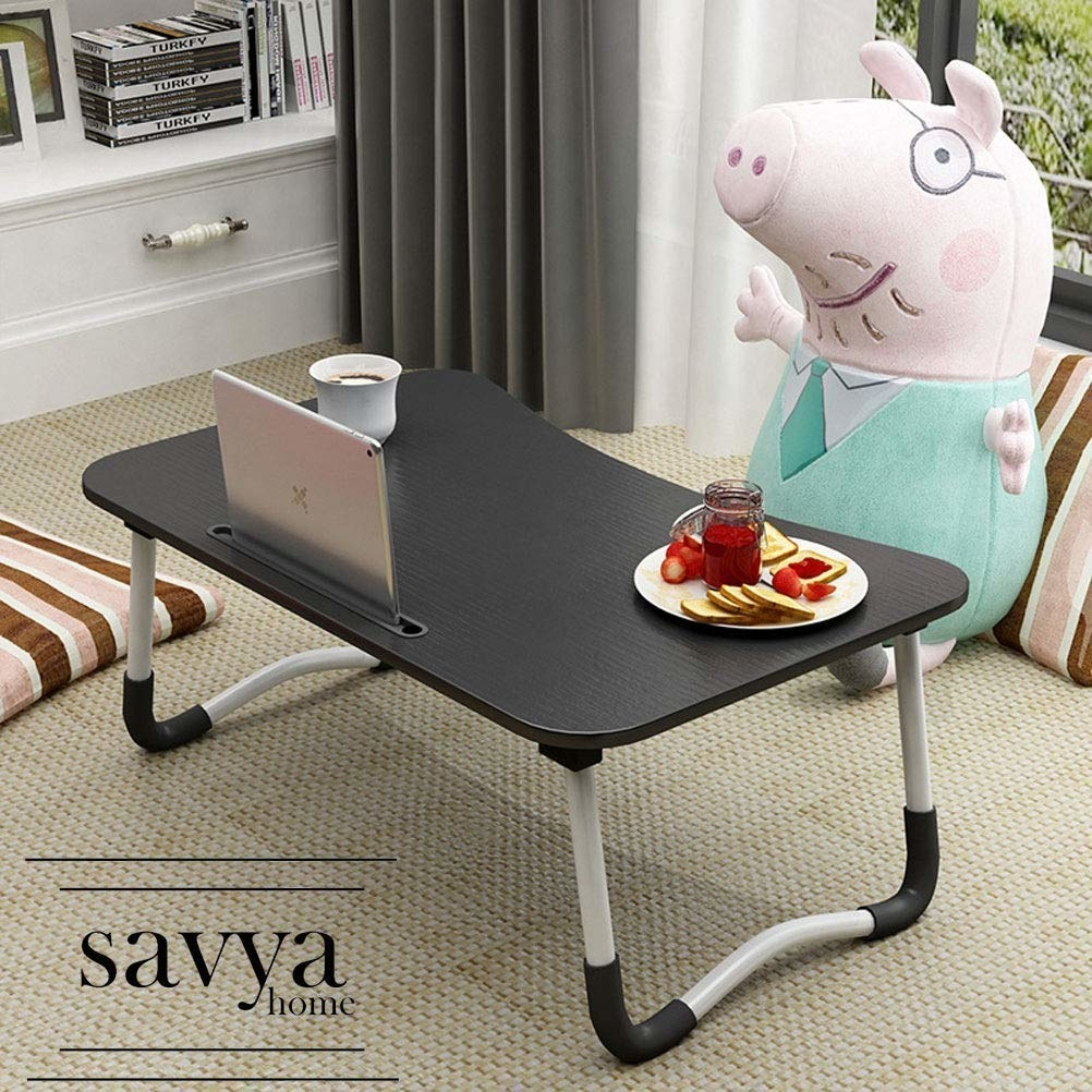 Lapdesk kept on a bed with a pig plushie sitting in front of it, with toast and jam, coffee, and an iPad on the lapdesk.