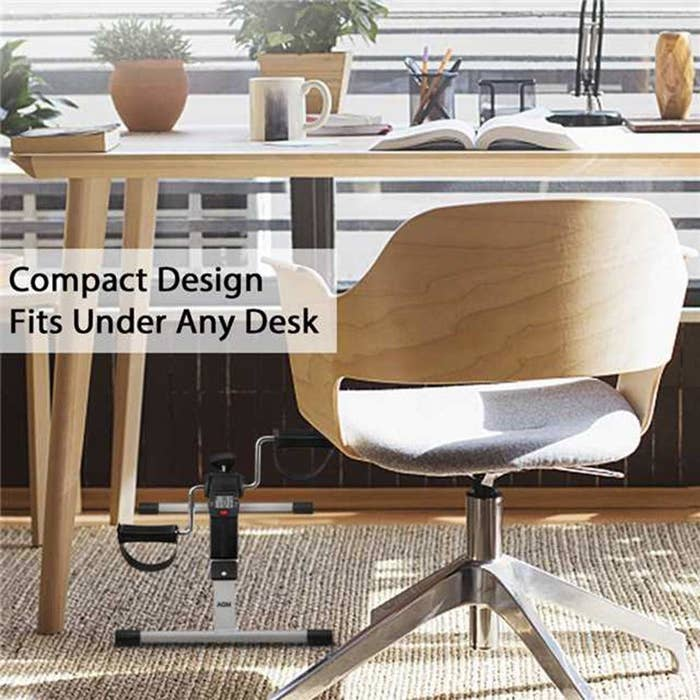 "Pedal cycle kept under a desk, with text on the image reading ""Compact design fits under any desk."""