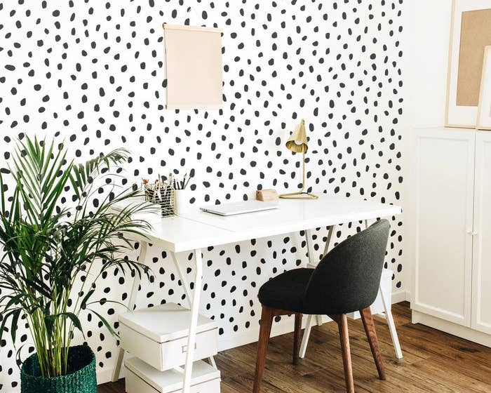 An office wall covered in polka dot decals