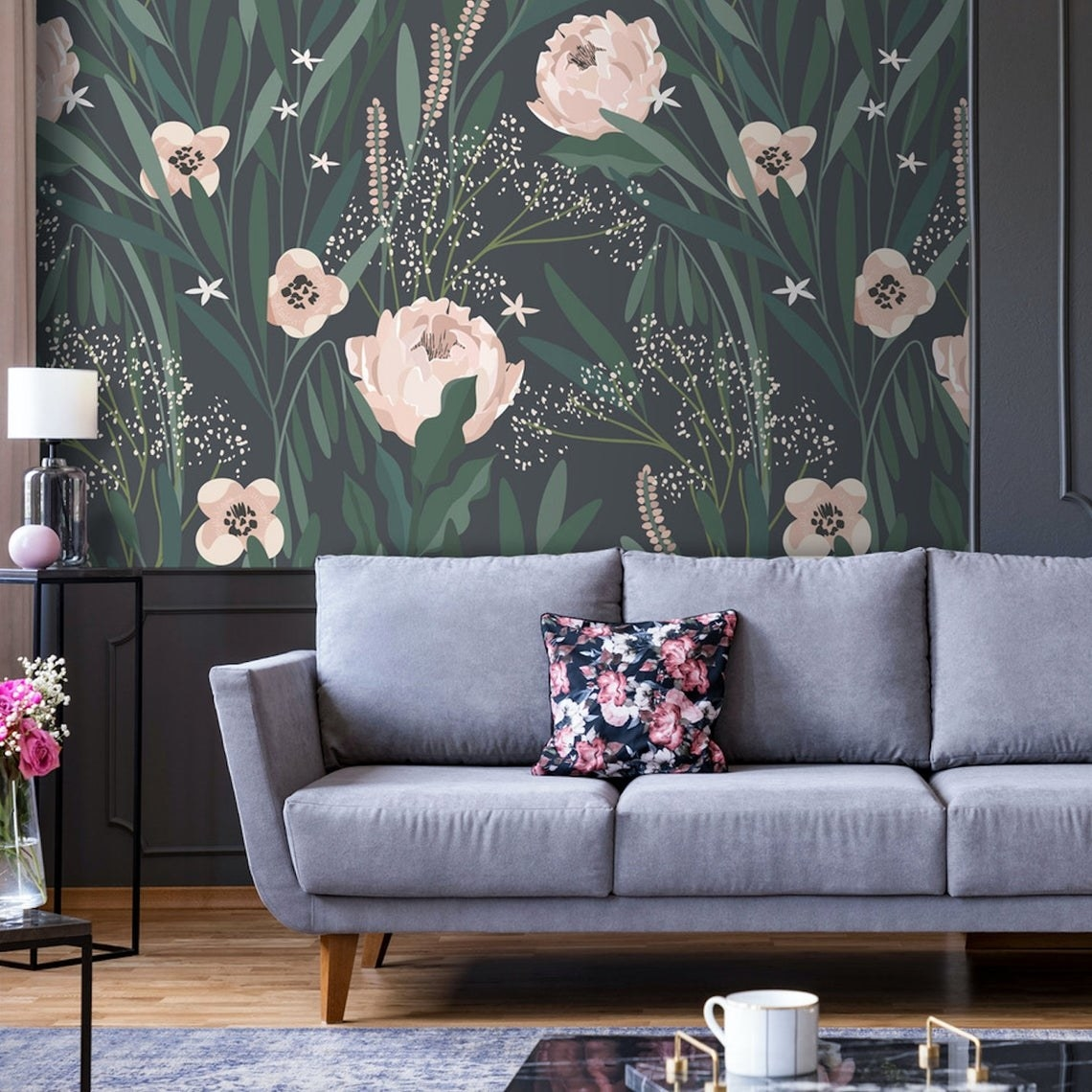 The wall behind a couch covered in the floral wallpaper
