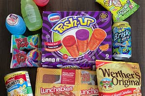 A bunch of popular '90s snacks sitting on a table