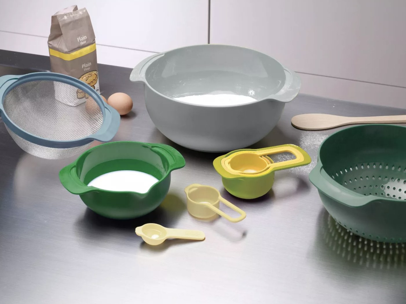 The 9-piece nesting bowl set in a kitchen