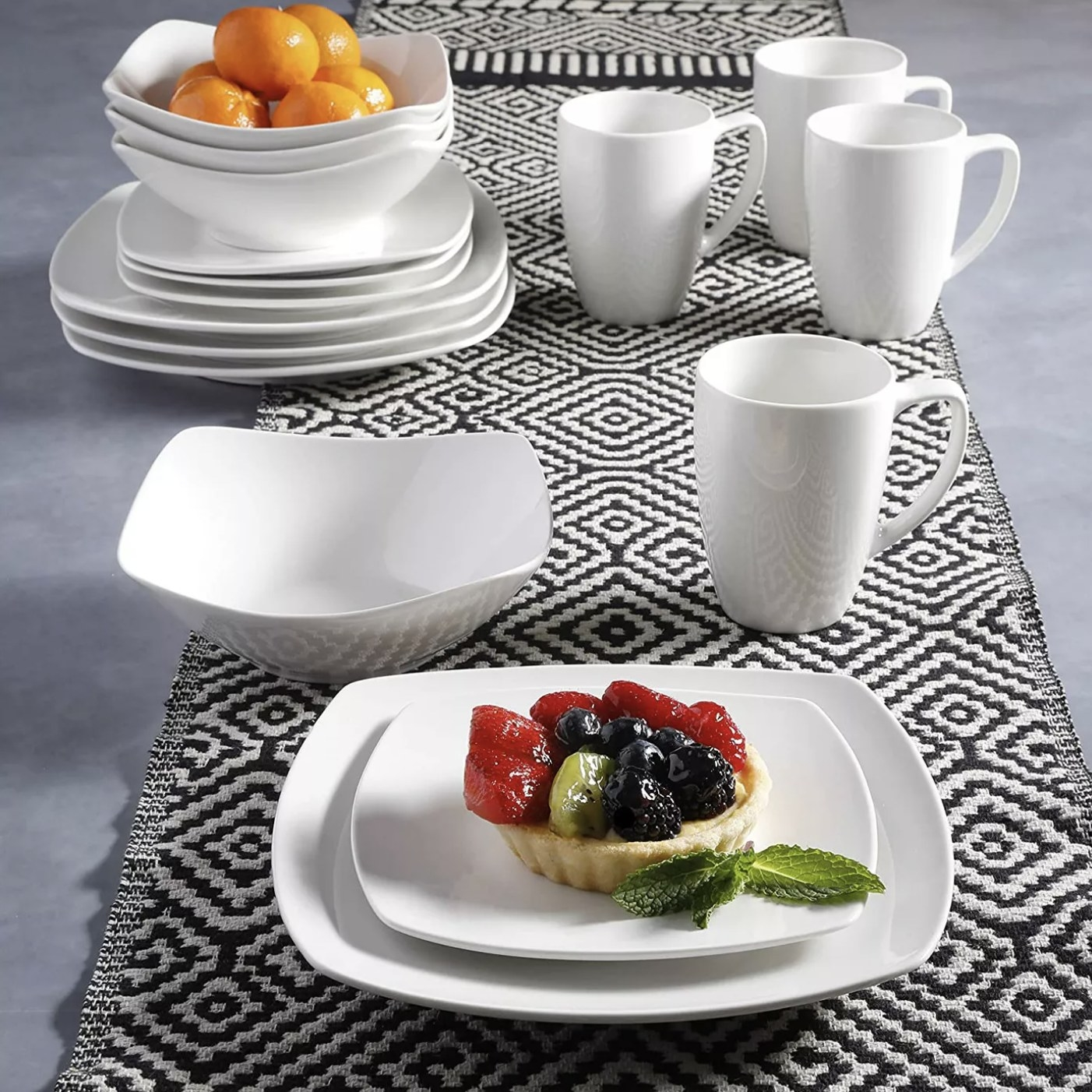 The white porcelain square plates on a table