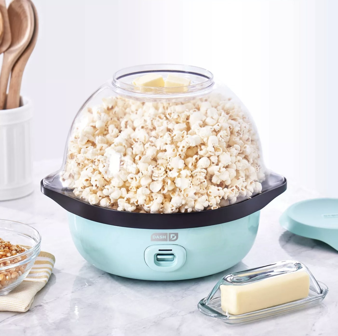 A light blue popcorn maker in a kitchen space