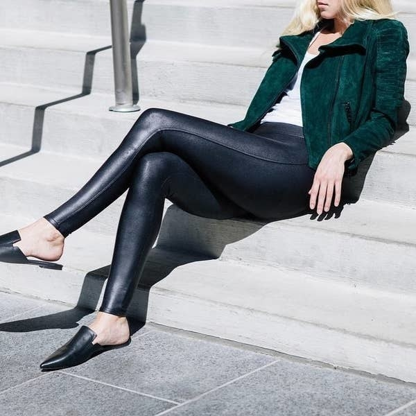 Model wearing the full-length leggings with a leather-look to them