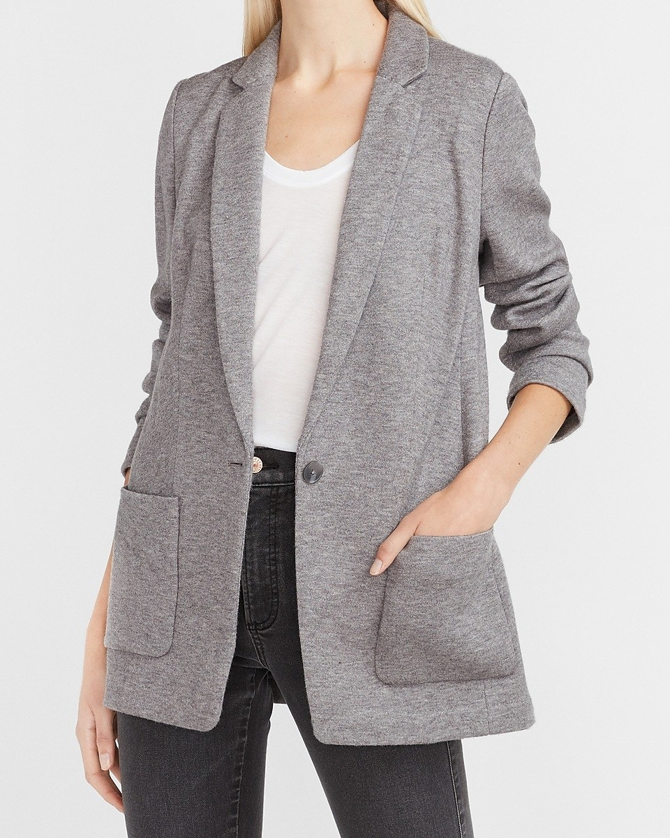 model wearing the knit blazer in gray
