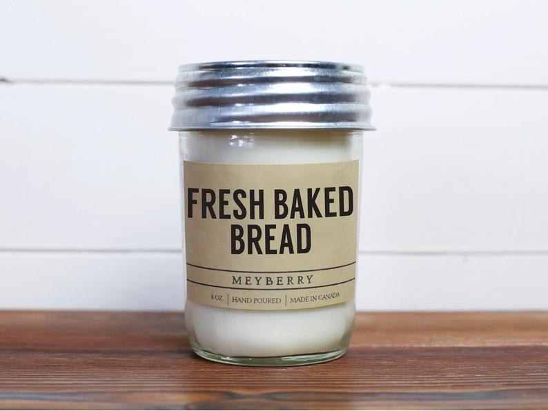 A candle in a jar labelled fresh baked bread