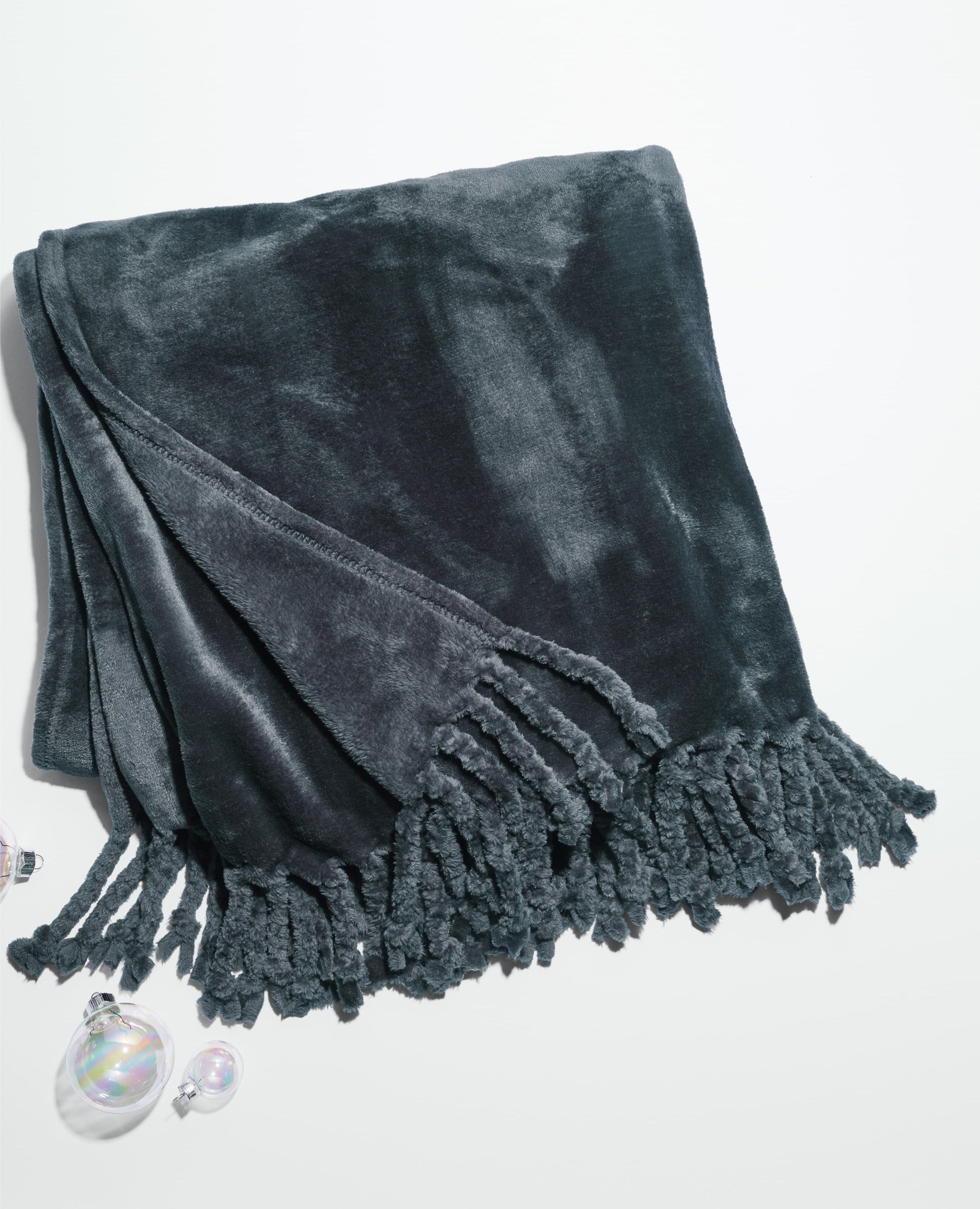The dark grey velvet-link blanket with fringe on the ends