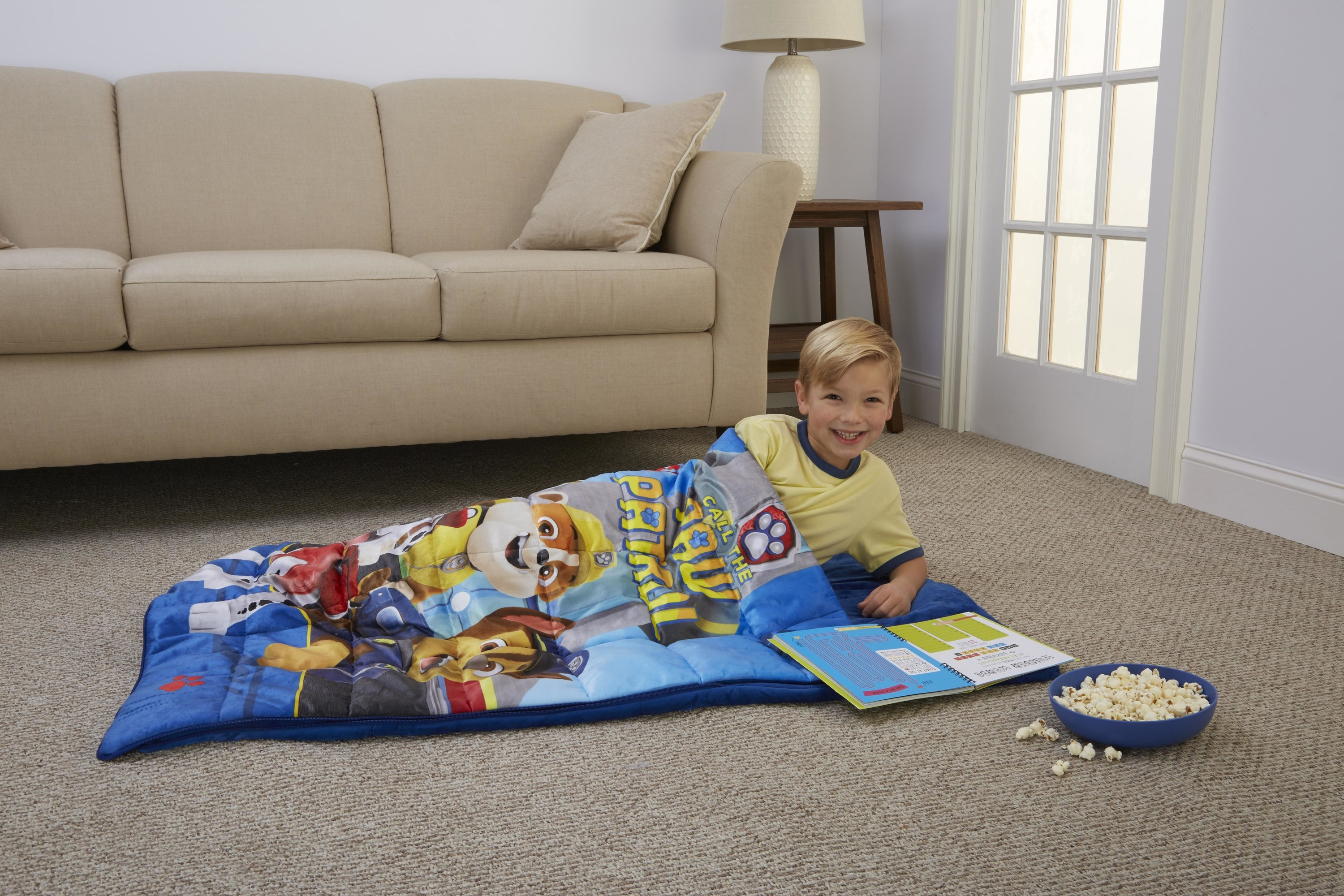 child in a paw patrol weighted blanket sleeping bag