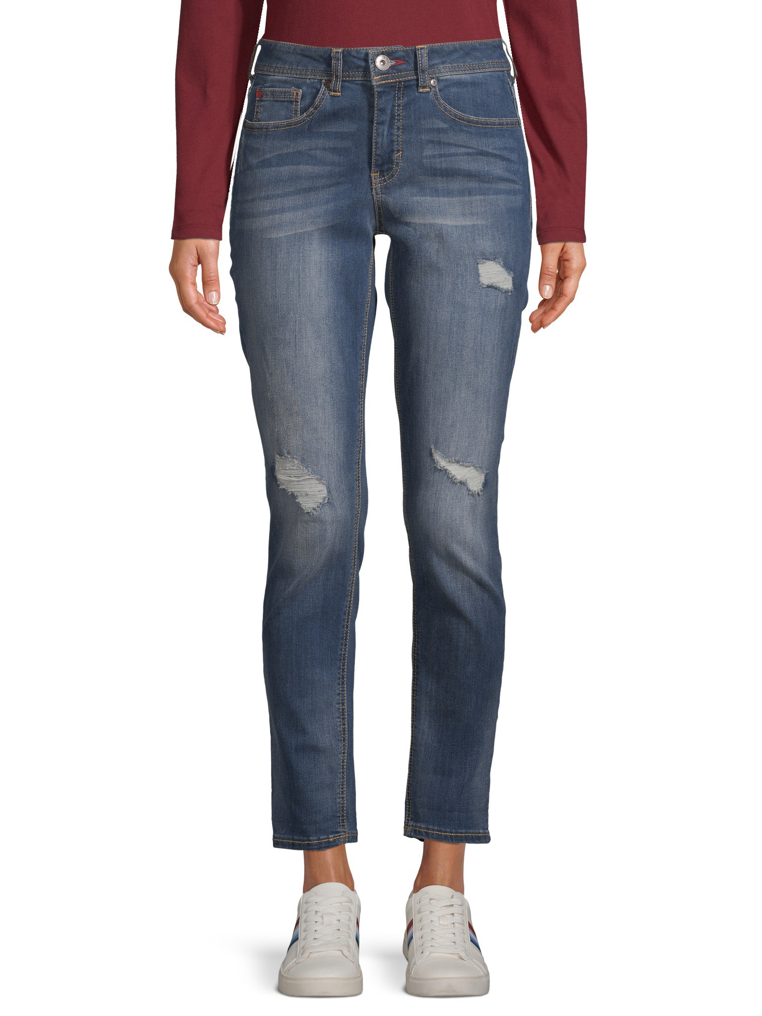 person wearing a relaxed fit jean in a dark wash