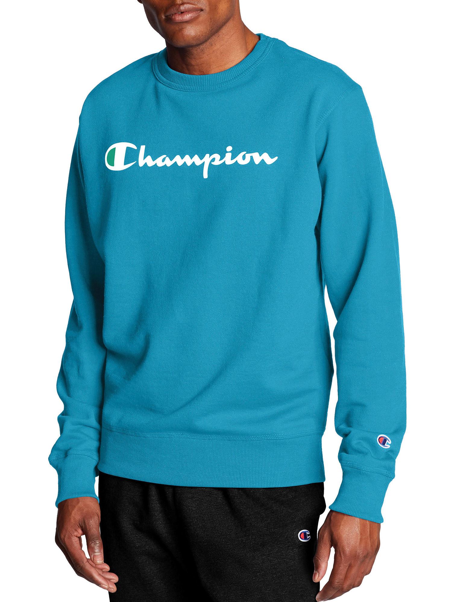 person wearing a blue champion crewneck sweatshirt