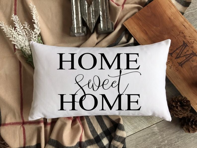A pillow that says home sweet home