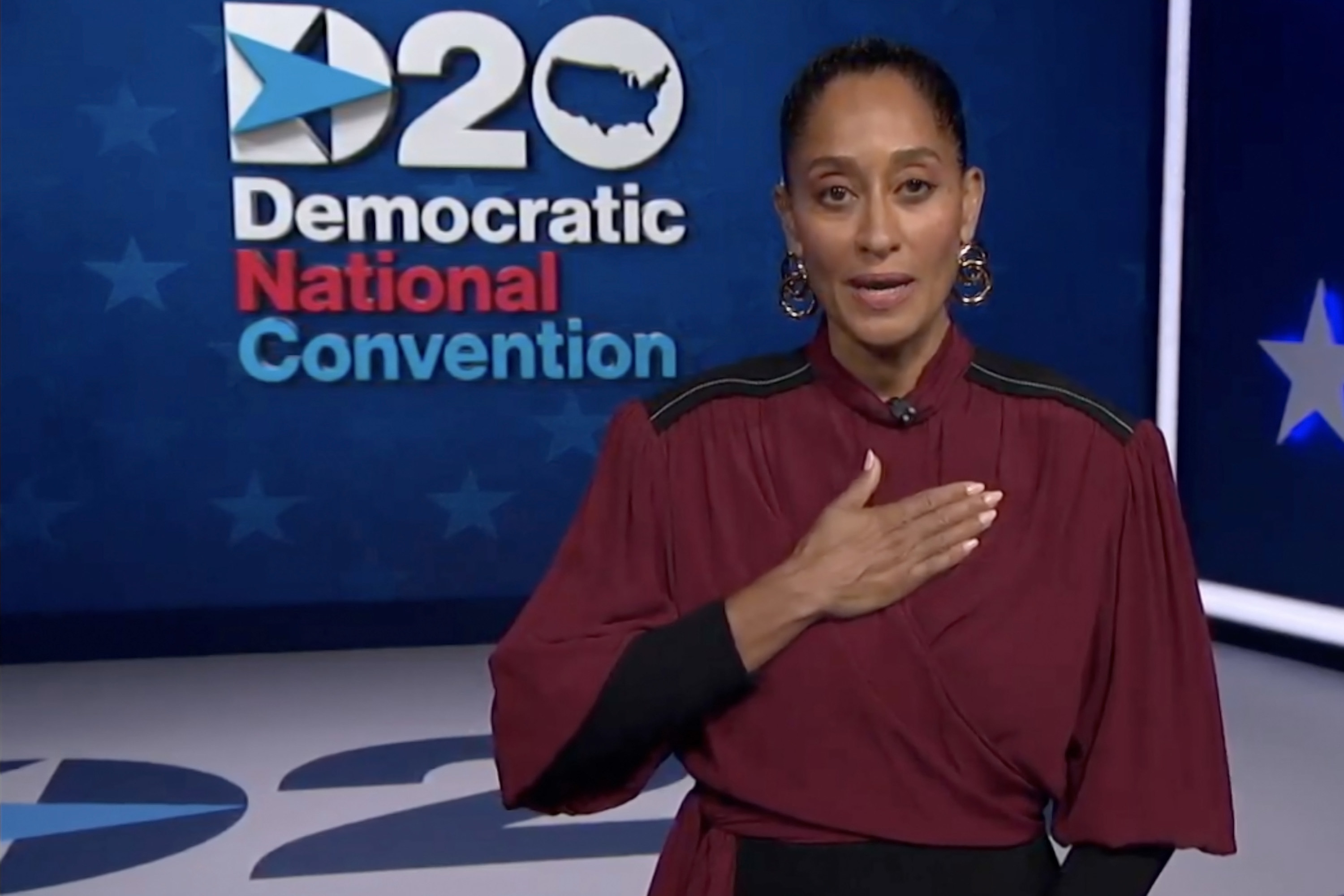 Tracee with her hand over her heart while speaking at the 2020 Democratic National Convention