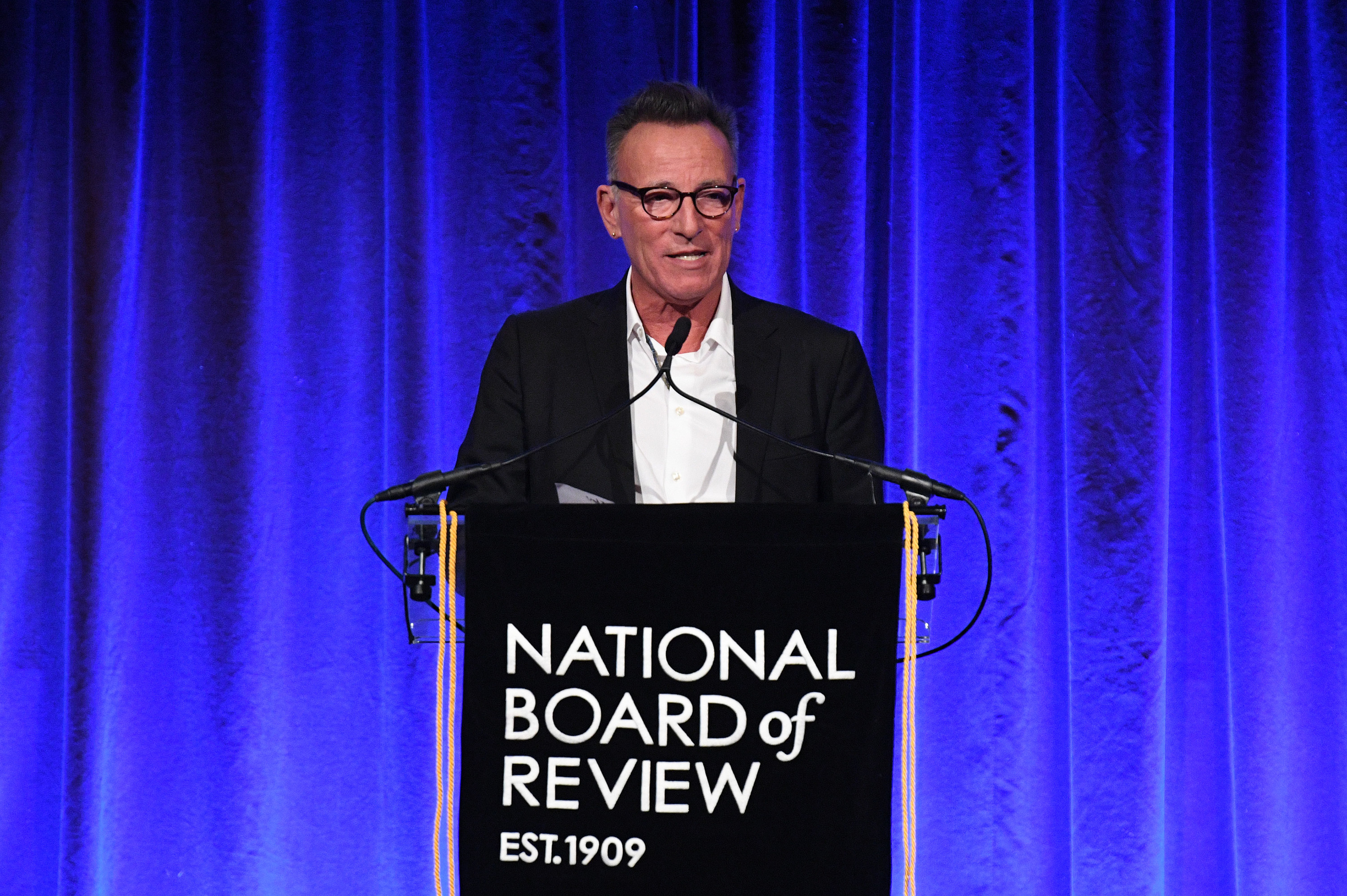 Bruce speaking at a National Board of Review event