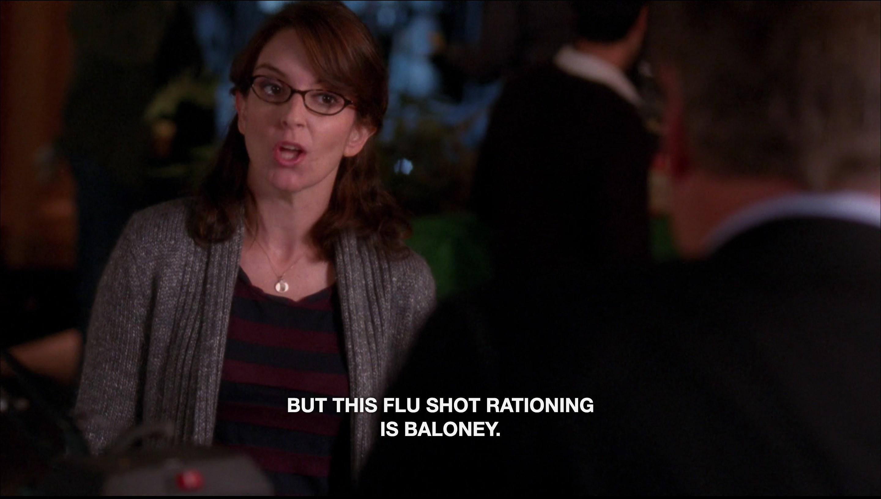 """A woman speaking with the caption text """"But this flu shot rationing is baloney"""""""