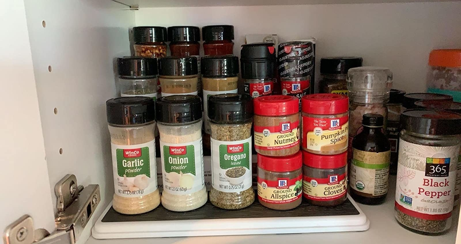 A reviewer's photo of the pantry organizer used with spices
