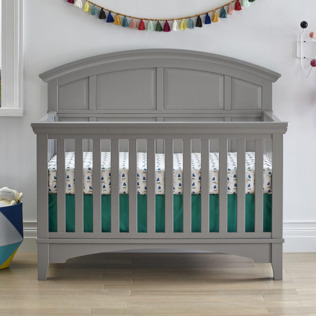 gray convertible crib in a nursery