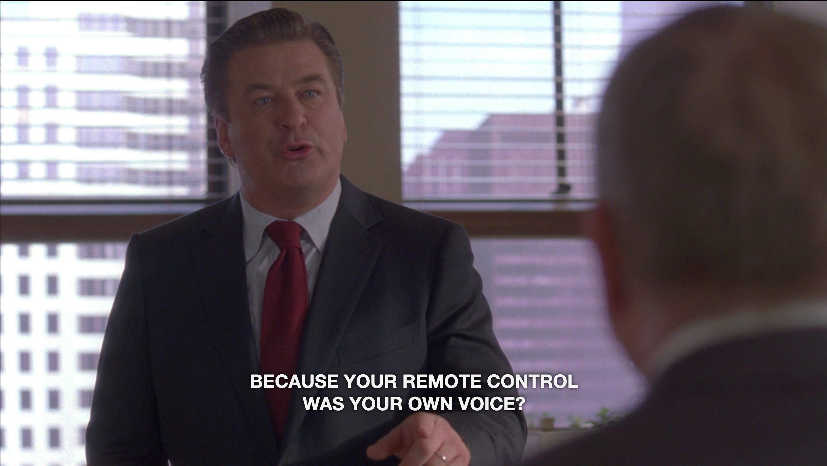 """A man in a suit with the caption text """"Because your remote control was your own voice?"""""""
