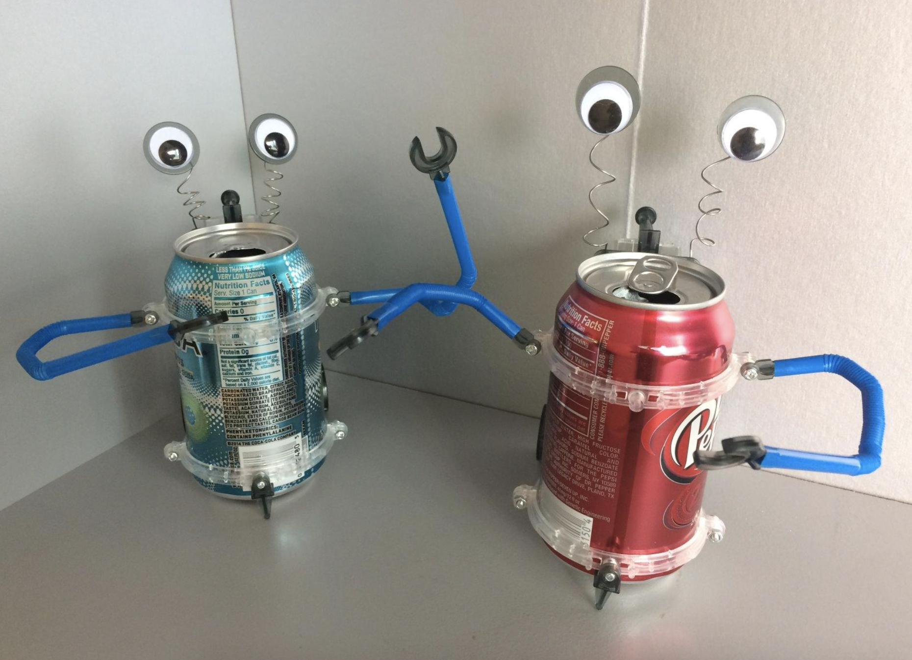reviewer images of two cans turned into robots