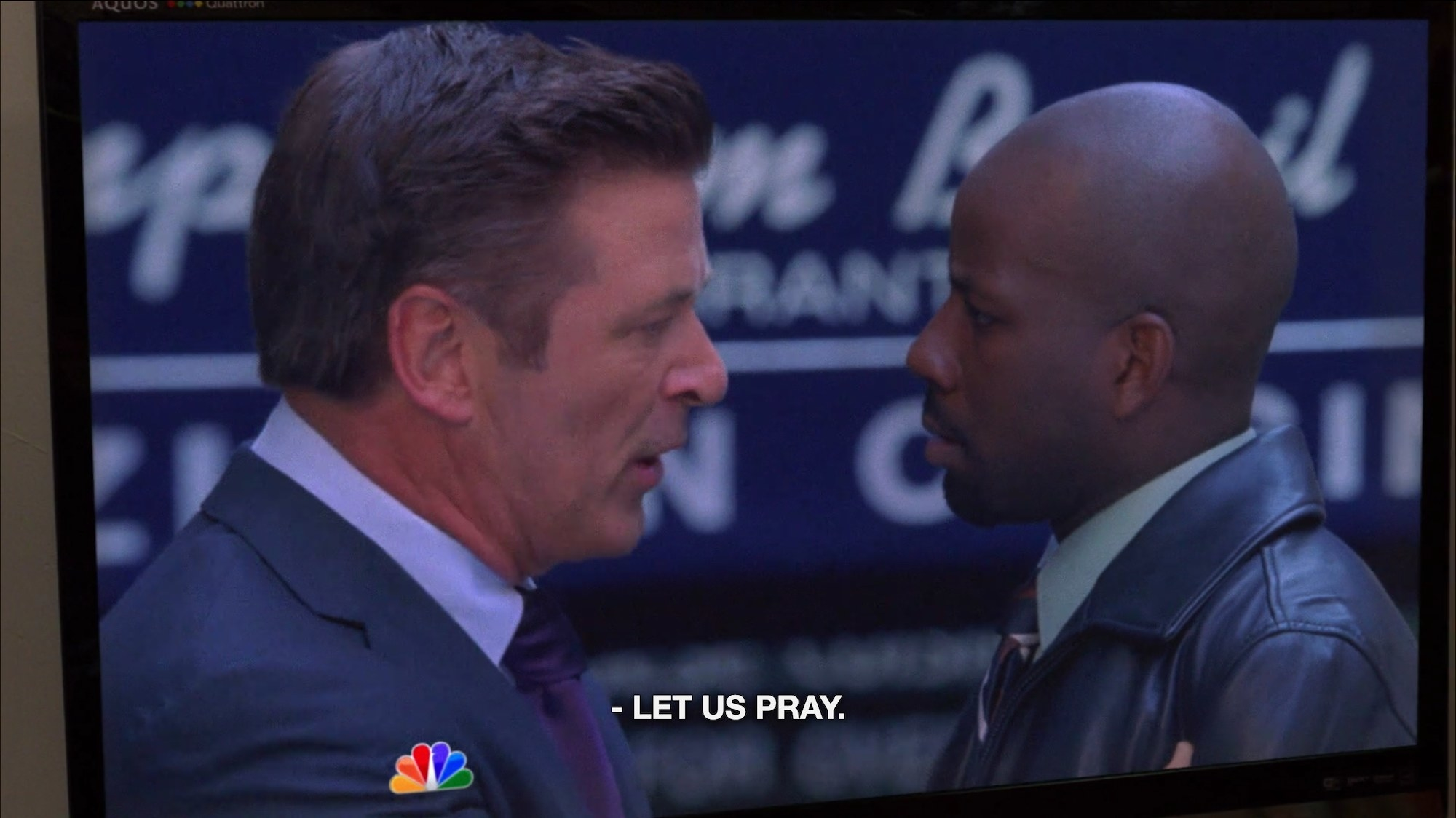 """Two men looking at each other with the caption text """"Let us pray"""""""