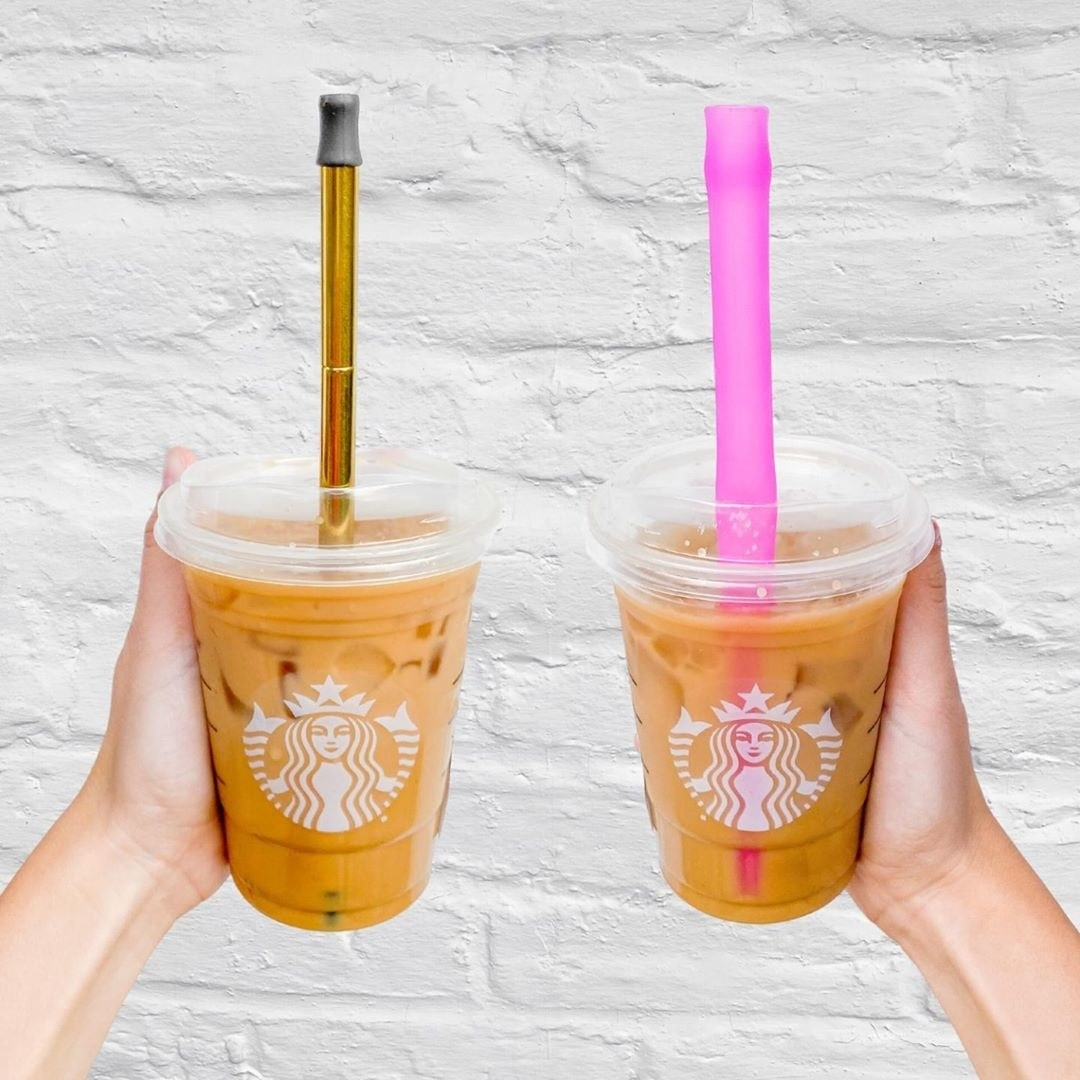 two models holding a starbucks drink each with a different finalstraw in it