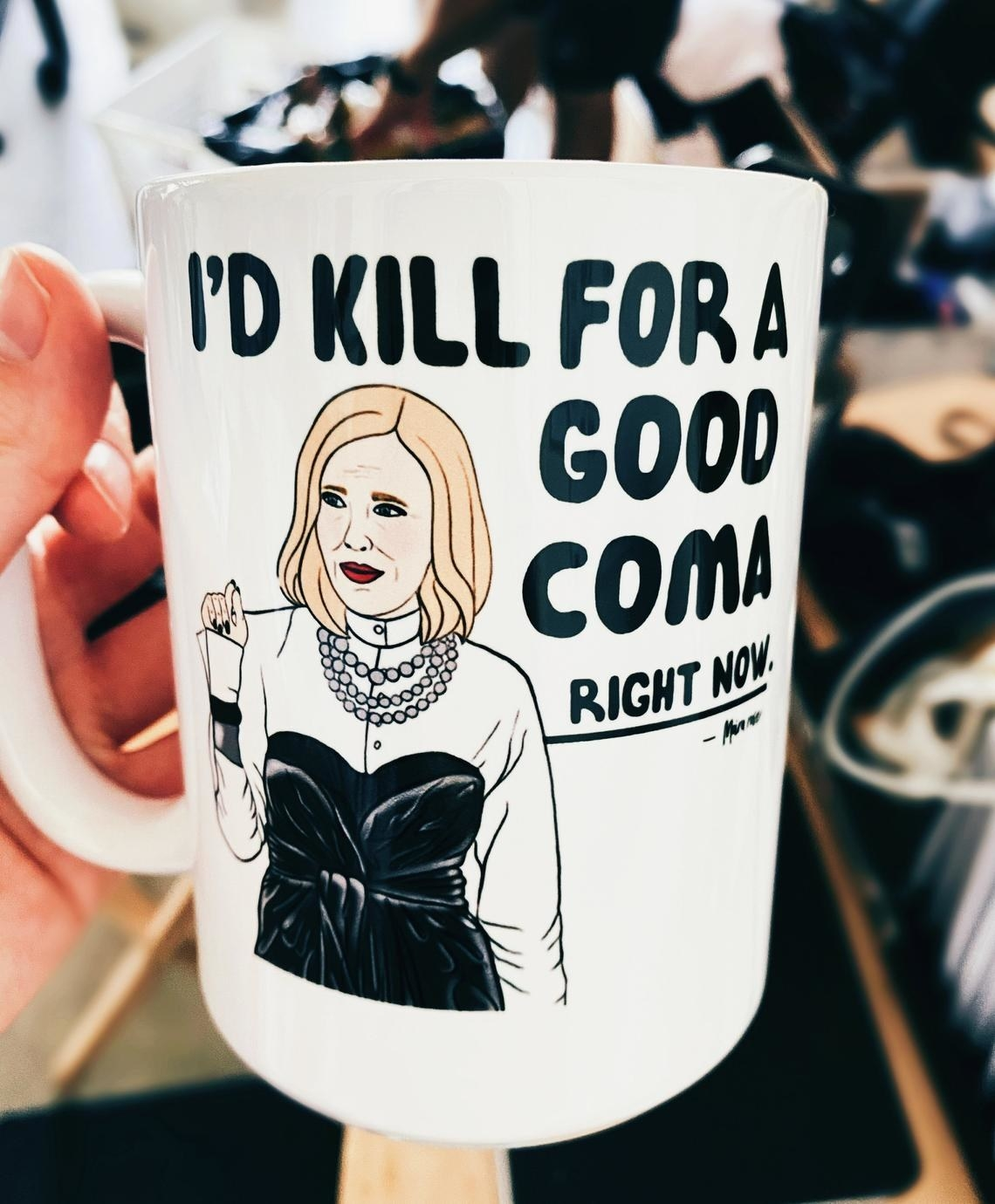 """A cartoon of Moira Rose saying, """"I'd kill for a good coma right now"""""""