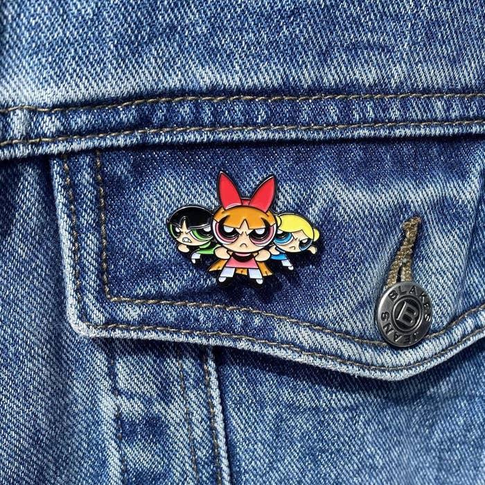 A Powerpuff Girls pin on a jean jacket