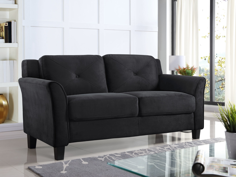 black loveseat in a bright living room