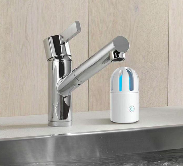 The bullet-shaped sanitizing light sits next to a faucet