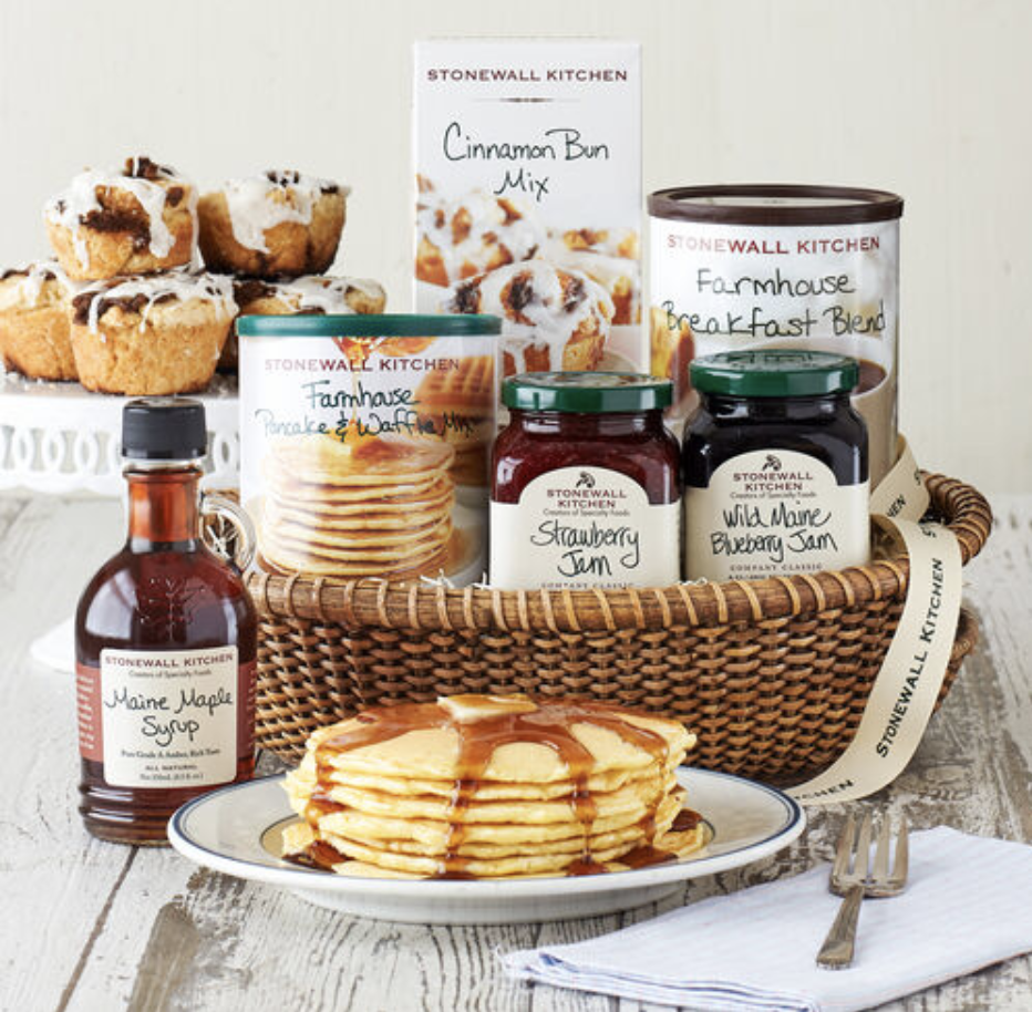 The contents of the gift set in a brown wicker basket
