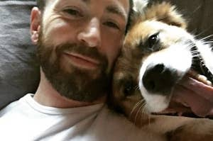 Chris Evans smiling with his dog