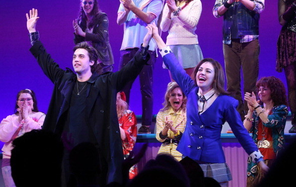 Veronica and J.D. taking bows onstage
