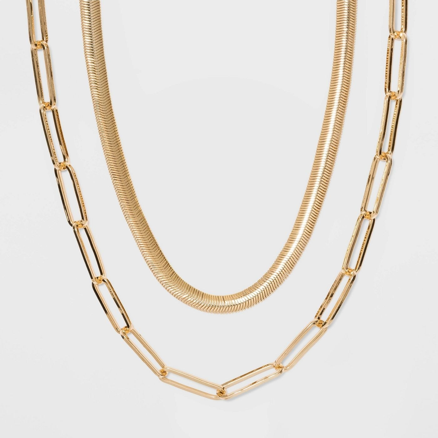 Gold chain necklace and shorter gold necklace together