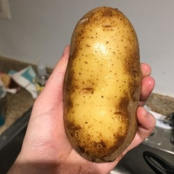 The same reviewer's after photo of a clean potato