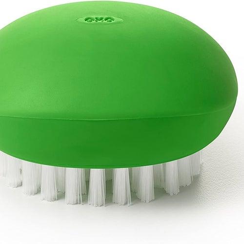 The green veggie brush