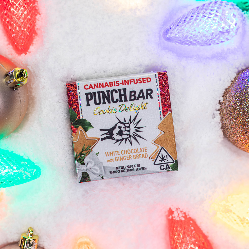 White chocolate with ginger bread PUNCH bar surrounded by holiday lights and atop artificial snow