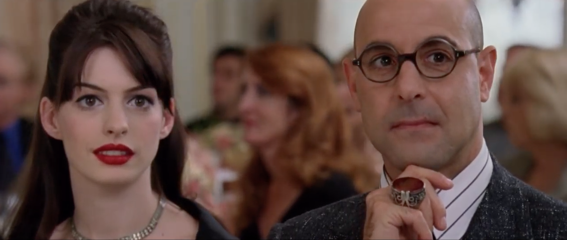 Anne and Stanley at a party in The Devil Wears Prada