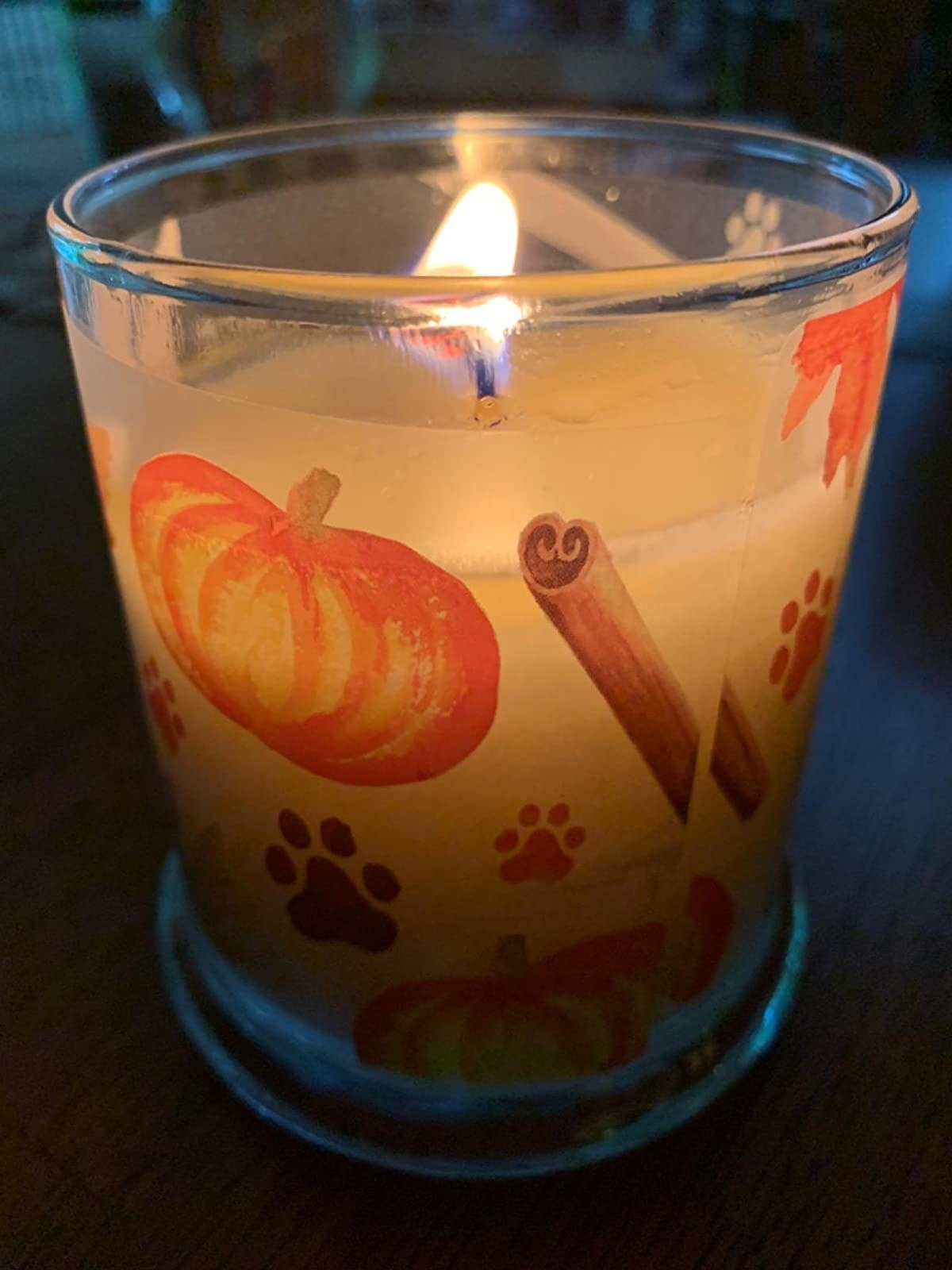 The candle, in pumpkin scent